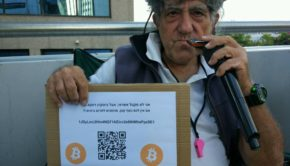 Mike Van-Cool with his Bitcoin sign. Image: Gavriel Goidel
