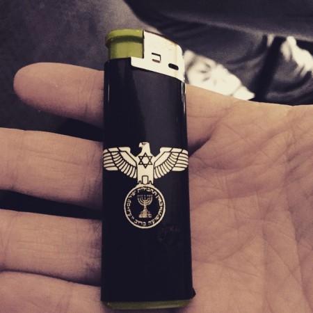 מצית עם לוגו עיט הרייך וסמל המוסד. צילום: שי רינגל